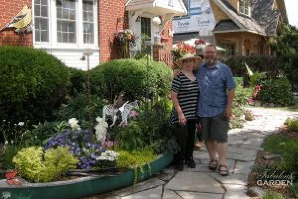 Sheila and Eugene in front of canoe garden