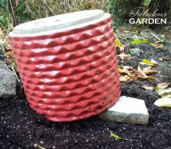 pot upside down with brick under it