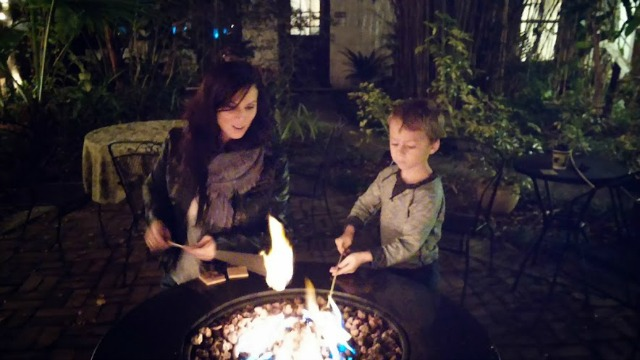 A full-bellied Little Fairytale Traveler with his smore's at the St. Francis Inn xx