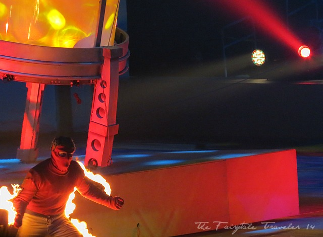 A performer on fire is part of the act.