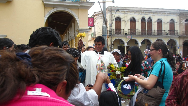 Priest blessing with holey water