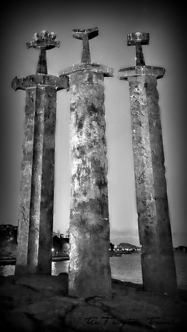 A black and white of the Three Swords Monument. Which stands about 33 feet tall.