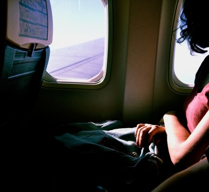 airplane stretches, entertainment while traveling, flight deals