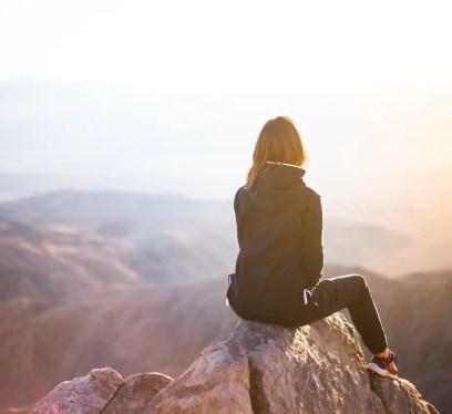 solo travel woman hiking, make money while traveling, travel nurse jobs