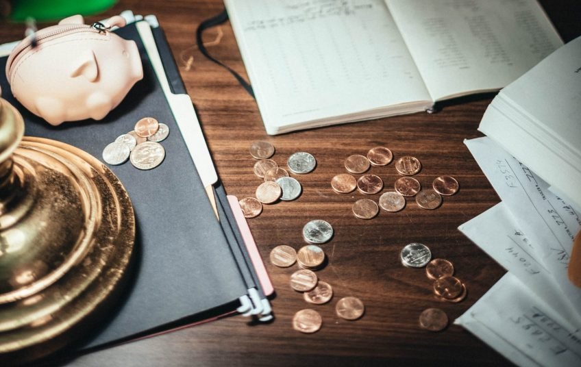 Save for travel, coins on desk