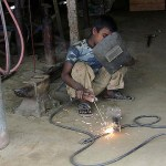 Child Labor - Welding in a Garage by uncultured at Flickr