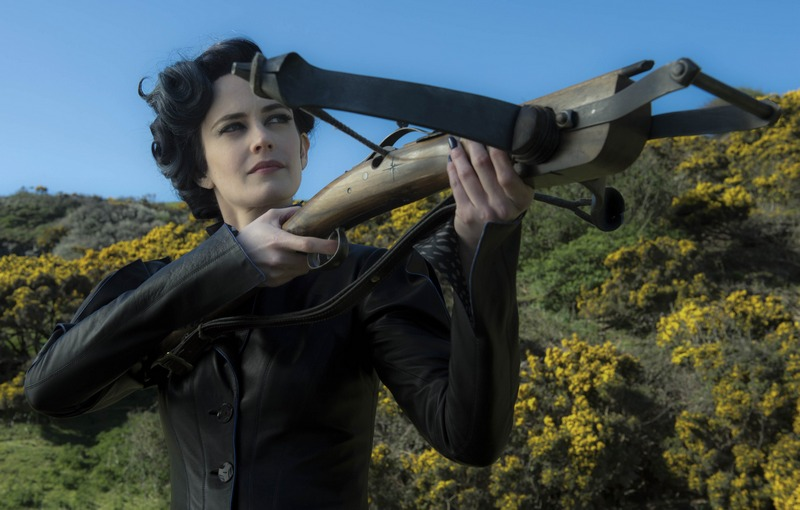 Miss Peregrine (Eva Green) takes aim at her powerful enemies. Photo Credit: Jay Maidment.
