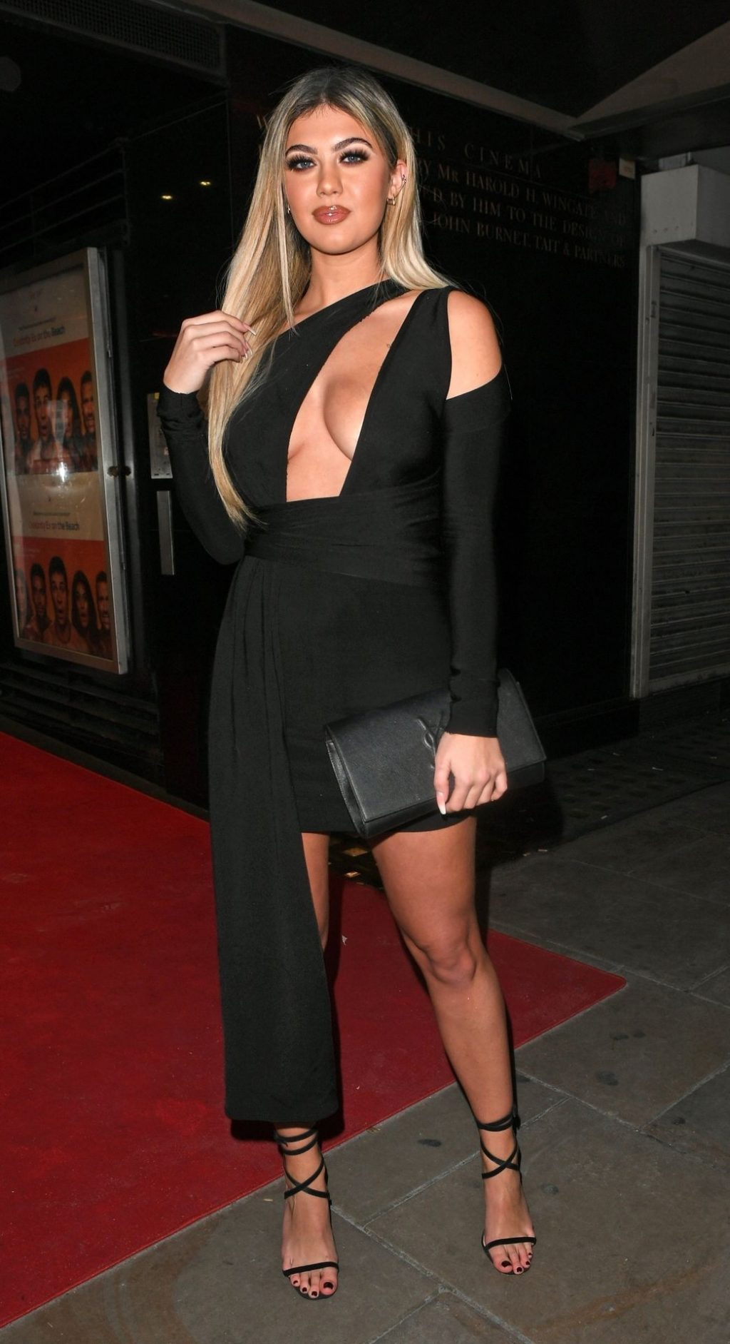 Belle Hassan Shows Off Her Cleavage in London (17 Photos)