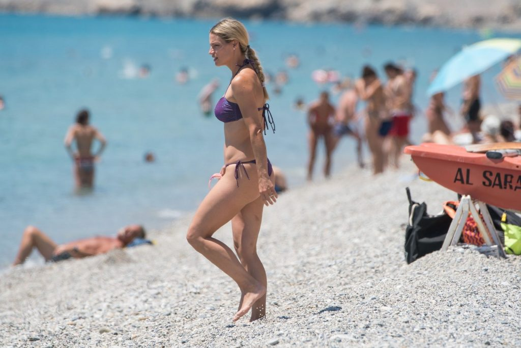 Michelle Hunziker Relaxes Swimming in the Sea (31 Sexy Photos)