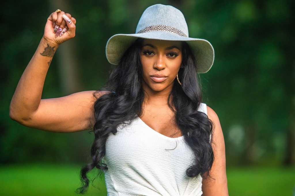 Porsha Williams Shows Off Her Cleavage at the BreonnaCon in Louisville (7 Photos)