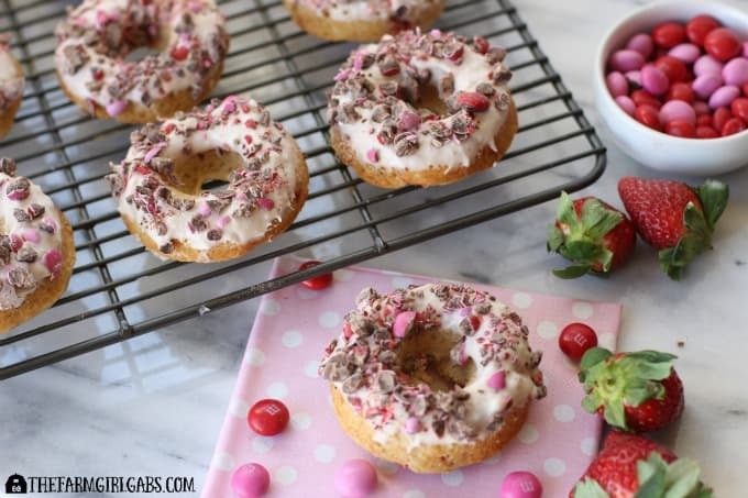It's the season of love, and what better way to celebrate than with a sweet ending like these Strawberries And Cream Doughnuts topped with M&M's® Strawberry. Ad #SendSweetness