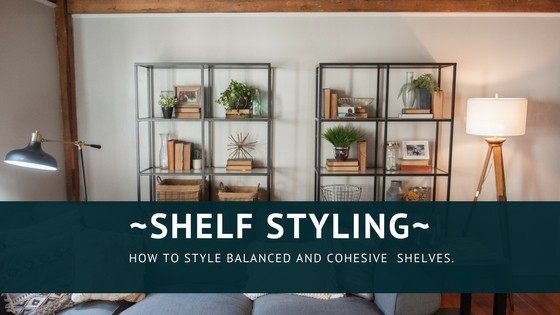 Open shelving in the living room with baskets and plants on them.