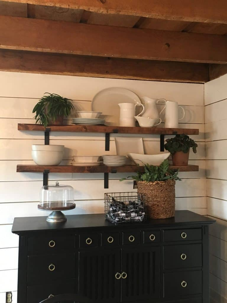 The wooden farmhouse shelves above the buffet.