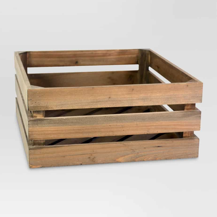 A wooden crate that could hold many items. Has a rustic look.