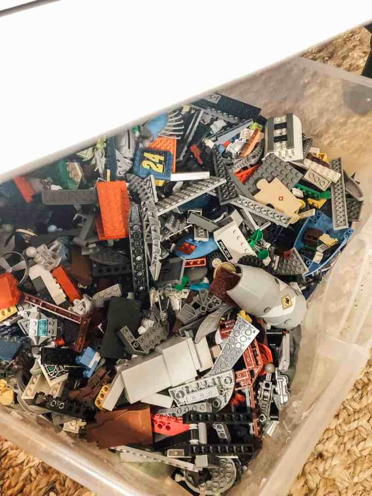 A plastic bin filled with lego.