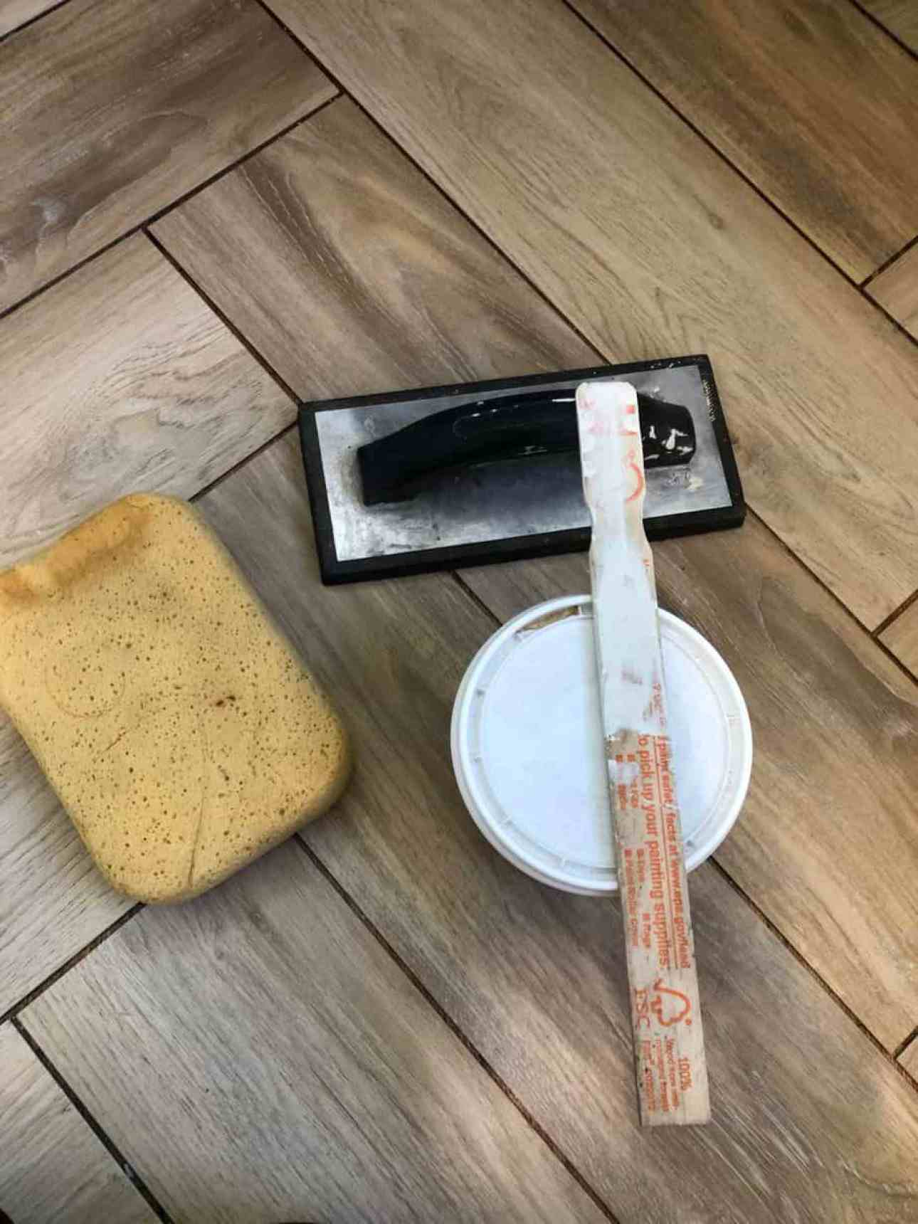 Grout tool and sponge.