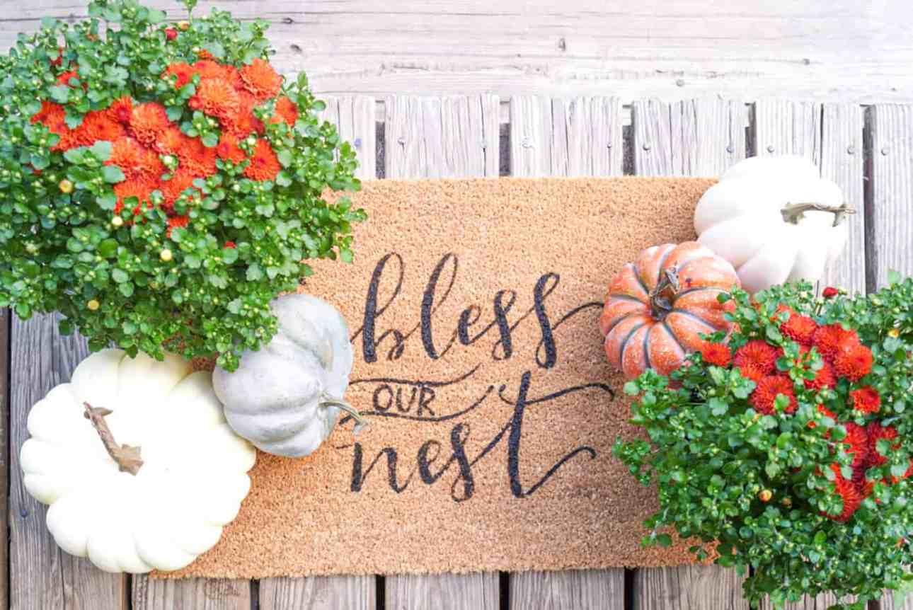 welcome mat that says bless this nest with pumpkins