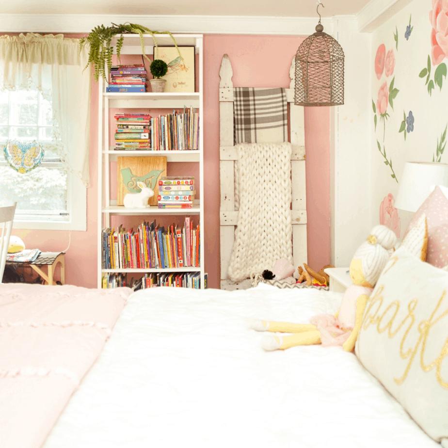 white bookshelf with white bed and blanket ladder