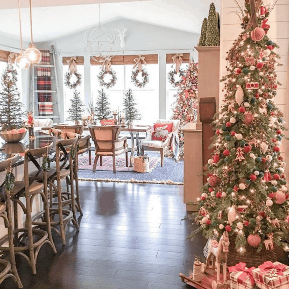 Christmas tree and wreaths in dining room hung with ticking ribbon