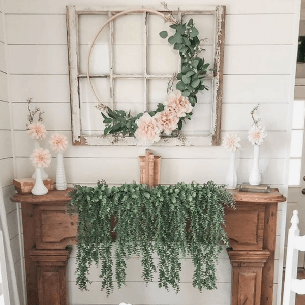 mantel decor with greenery singing down