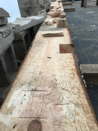 Each timber is marked for assembly.