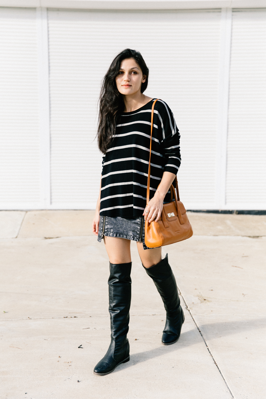 Mini skirt with knee high boots outfit.