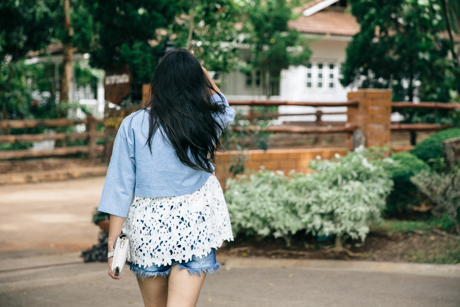 Chambray & floral lace trim blouse with frayed denim shorts.