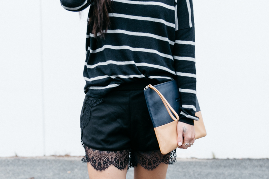 Black lace trim shorts with a navy blue sweater.