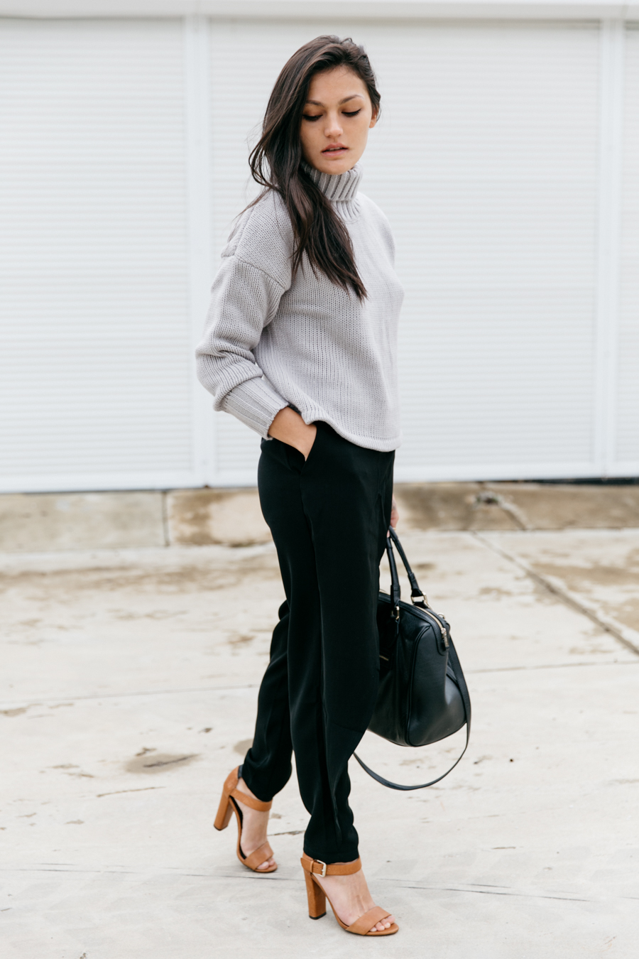 Roll neck jumper outfit with black pants.
