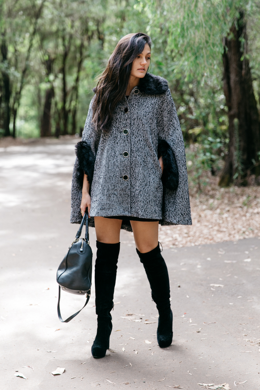Chic outfit with knee high boots.