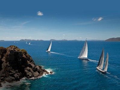 Competitors in the Loro Piana Caribbean Super Yacht Regatta head out into Oil Nut Bay