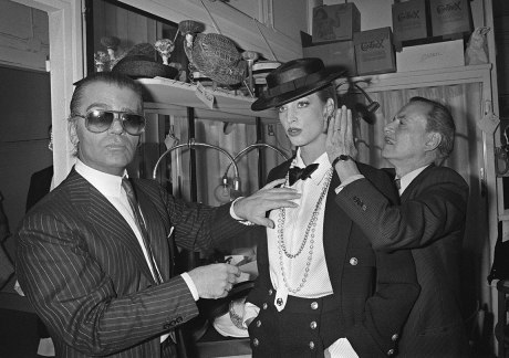 Lagerfeld gives a final touch to a model in January 1983, during the first that Lagerfeld designed for the house