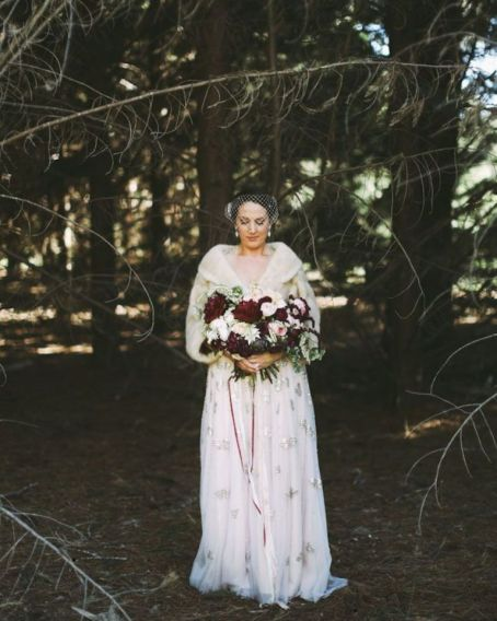 winter bride in the woods