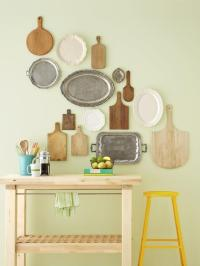 silver trays and cutting boards as wall decor