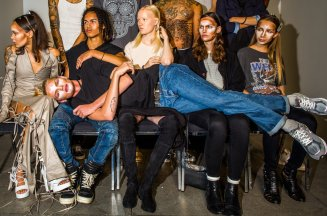Models waiting for their make-up to be finished backstage at Hood by Air.