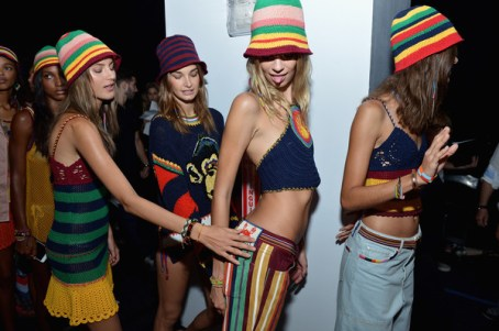 Models preparing to walk for Tommy Hilfiger getting cheeky.