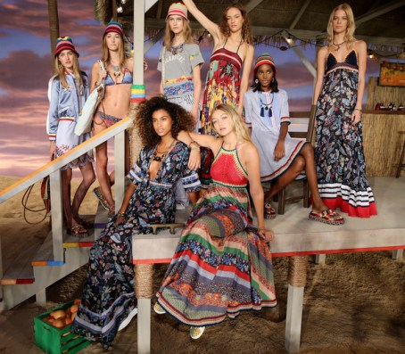 An array of models at Tommy Hilfiger, relaxing on the set.