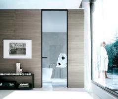 Rimadesio designer Giuseppe Bavuso's nautical theme defines the 'Jambs' series black aluminum frame and big glass panel with two-way opening. rimadesio.it