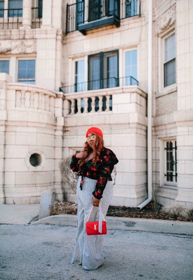 plus size travel, floral top, stripe pants, YSL red purse, red turban, plus size blogger