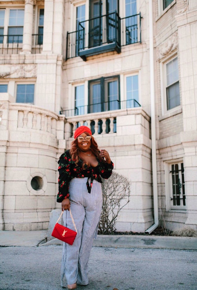 plus size travel, floral top, stripe pants, YSL red purse, red turban