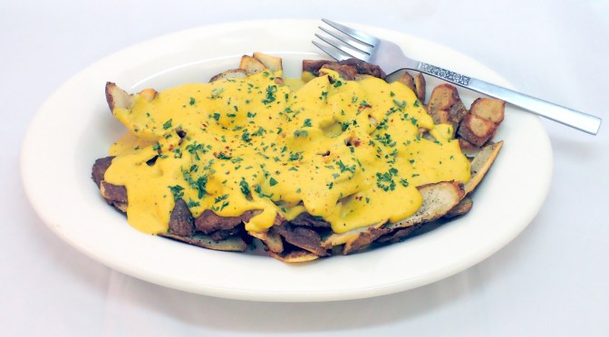 Fried potato skins and Vegan cheese sauce