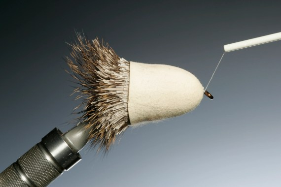 Now for a easy trouble free whip finish just slide the finger tip over the hook and deer hair. Remove the tip after you have whip finished and removed your tying thread.
