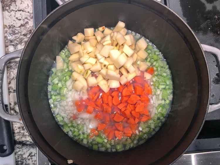 simmering veggies in clam juice
