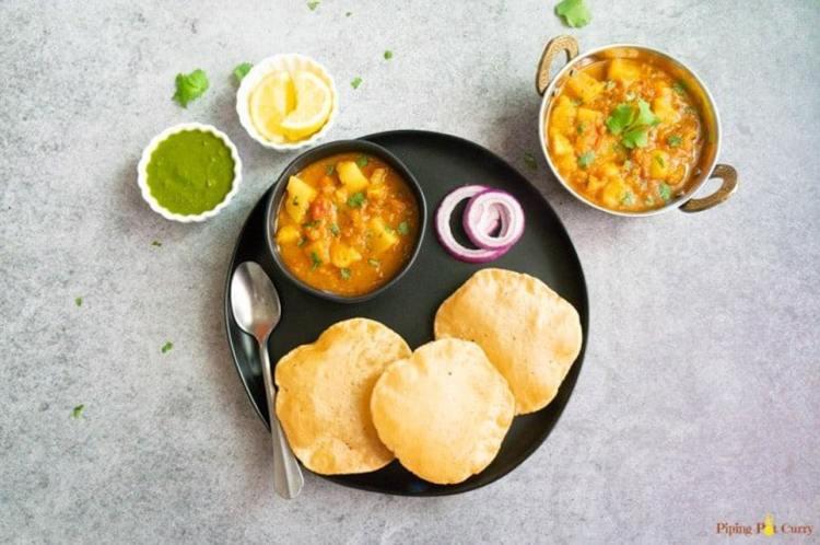 potato curry in tomato gravy