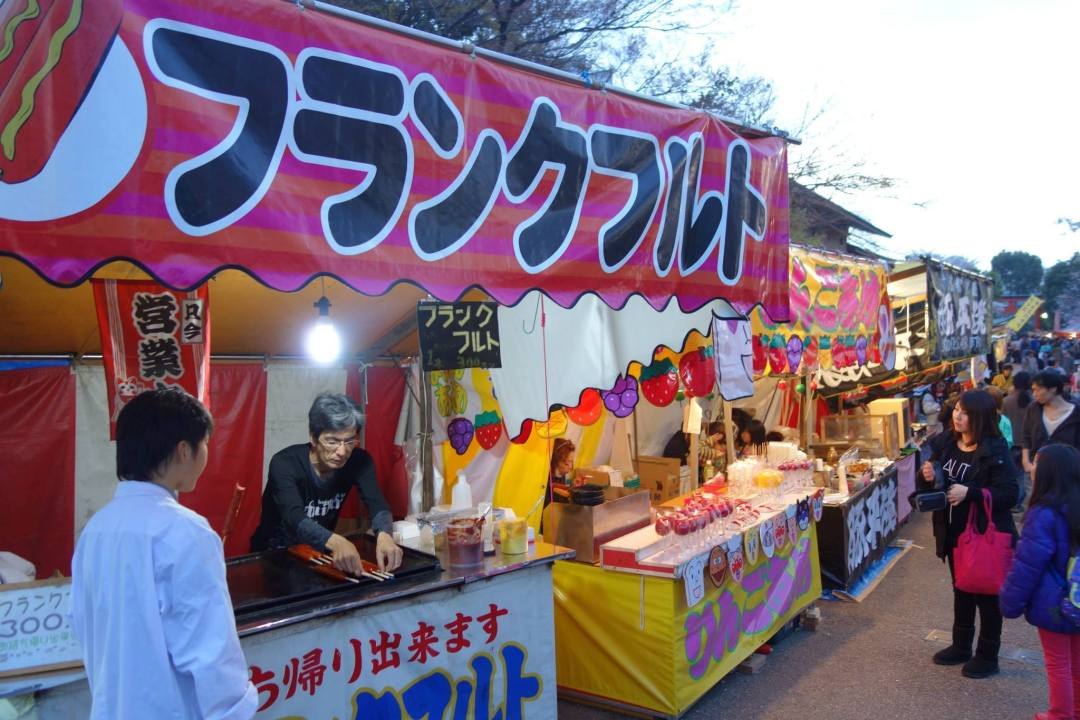 Food vendors outside the Yasaka Shrine with amazing candied strawberries