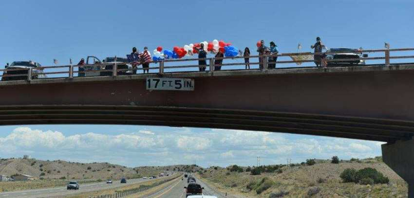 Family greets the convoy as they pass. Courtesy of the Velasquez family.