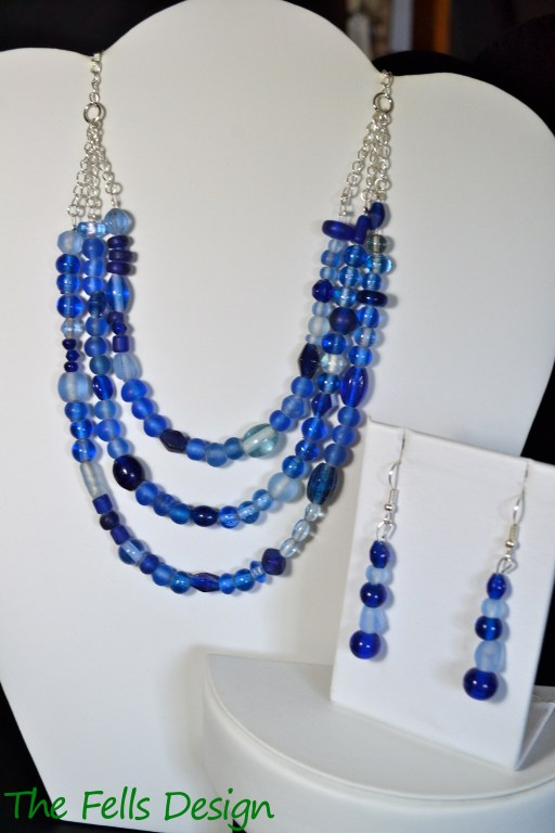Blue Glass beaded multi-strand necklace and earrings
