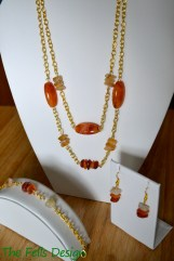 Repurposed orange stone necklace, bracelet, and earrings on gold chain