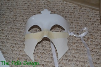 Attach them to the bottom of the mask using masking tape.