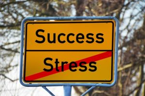 stress and success sign
